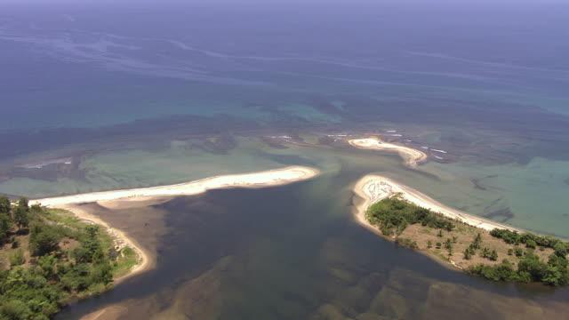 Aerial over river estuary and coast, Madagascar