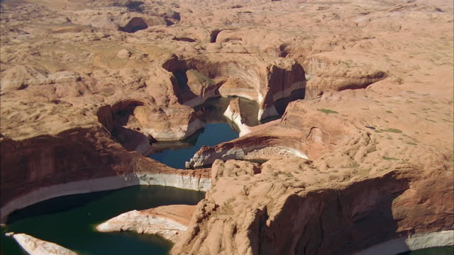 aerial over rock formation in lake powell / southwest usa - lake powell stock videos & royalty-free footage