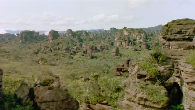aerial over rock formations and trees / venezuela - venezuela stock videos & royalty-free footage