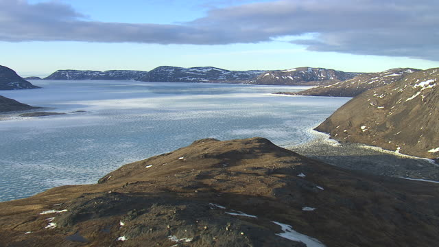 aerial over rocky coast, inlet and sea ice, quebec, canada - bay of water stock videos & royalty-free footage
