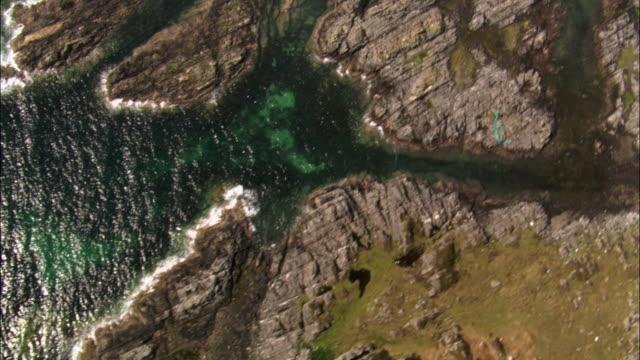 aerial over rocky coast, scotland, uk - coastline stock videos & royalty-free footage