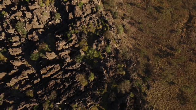 aerial over rocky peaks of cliff in winjana national park - outback stock videos & royalty-free footage
