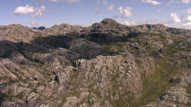 "stockvideo's en b-roll-footage met aerial over rocky peaks of tsaranoro massif, madagascar - ""bbc natural history"""