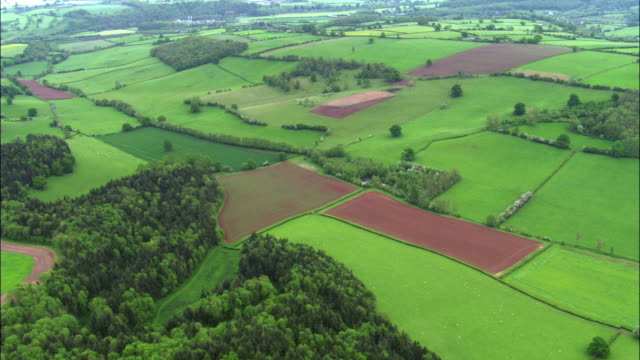 Aerial over rolling Malvern Hills and farmland, Worcestershire, UK