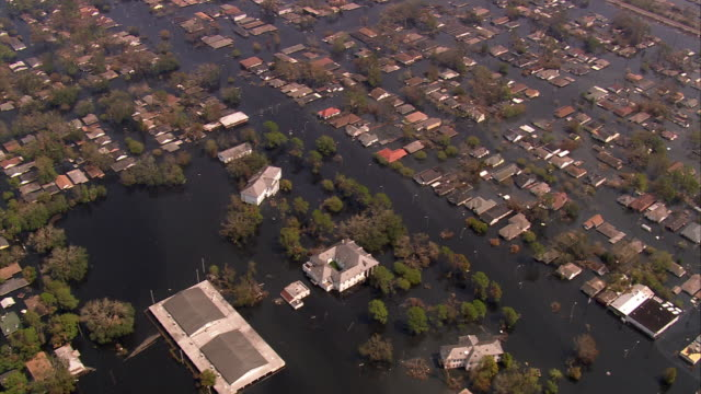 aerial over rooftops and flooded streets of gentilly subdivision / new orleans louisiana - hurricane katrina stock videos and b-roll footage