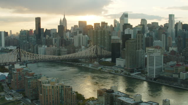Aerial over Roosevelt Island with 59th street bridge and Manhattan in the background