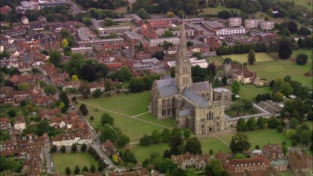 vídeos de stock e filmes b-roll de aerial over salisbury cathedral/ salisbury, england - circa 13th century