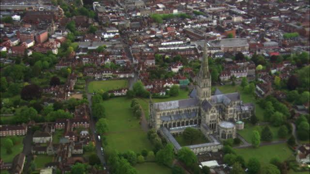 stockvideo's en b-roll-footage met aerial over salisbury cathedral, wiltshire, uk - wiltshire