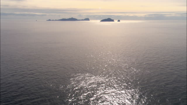 aerial over sea and st kilda, scotland, uk - tranquility video stock e b–roll
