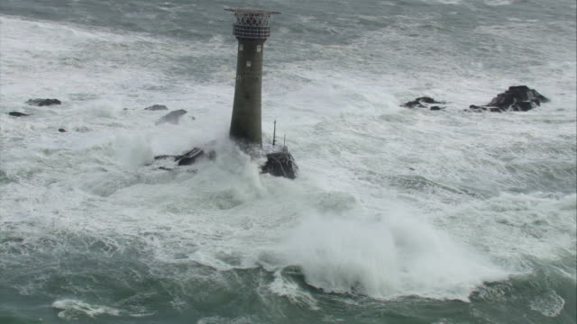 aerial over sea crashing against lighthouse, uk - broken stock videos & royalty-free footage