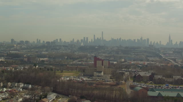 aerial over secaucus, nj with new york city skyline on the horizon - new jersey stock videos & royalty-free footage