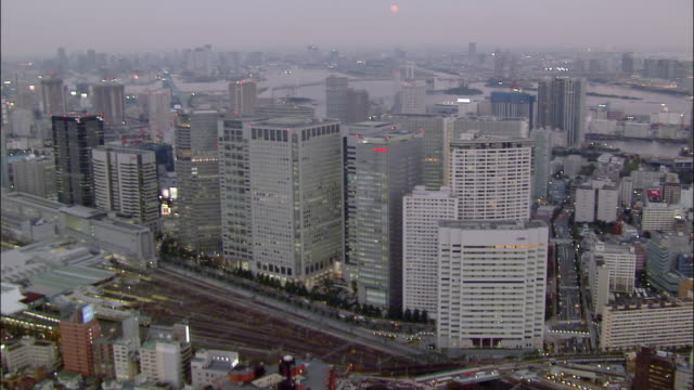 aerial over shiodome district, toward and over rainbow bridge/ tokyo - approaching stock videos & royalty-free footage