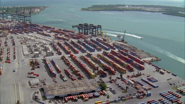 aerial over shipping dock / miami, florida - construction equipment stock videos & royalty-free footage