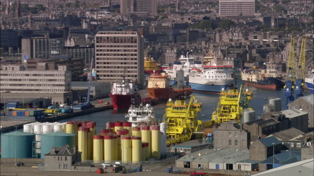 aerial over ships docked in aberdeen port / aberdeen, scotland - aberdeen schottland stock-videos und b-roll-filmmaterial
