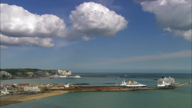 Aerial over ships in Dover harbor / Kent, England