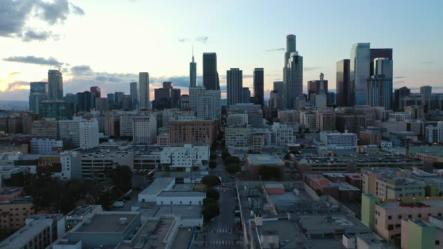 aerial over skid row downtown los angeles street during the covid-19 pandemic - twilight stock videos & royalty-free footage