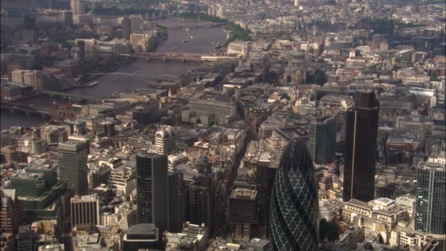 aerial over skyscrapers in city of london and river thames, 2007, london, uk - swiss re stock videos & royalty-free footage