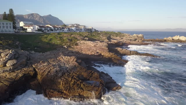 aerial over small coastal town at sunset - hermanus stock videos & royalty-free footage