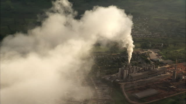 aerial over smoking factory, uganda - smoke physical structure stock videos & royalty-free footage