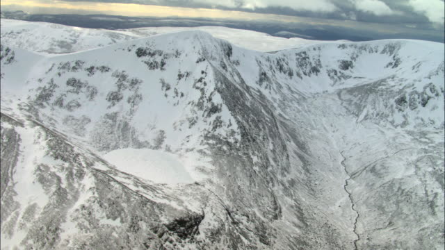 aerial over snow covered mountains, cairngorms, scotland - snow stock videos & royalty-free footage
