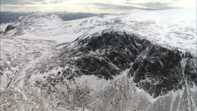 aerial over snow covered mountains, cairngorms, scotland - winter stock videos & royalty-free footage