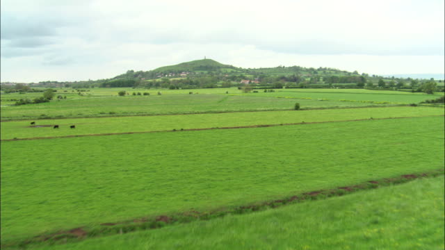 aerial over somerset levels towards glastonbury tor, uk - overcast stock videos & royalty-free footage