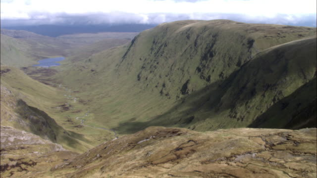 aerial over steep glacial valley and mountains, highlands, scotland - scottish highlands stock videos and b-roll footage