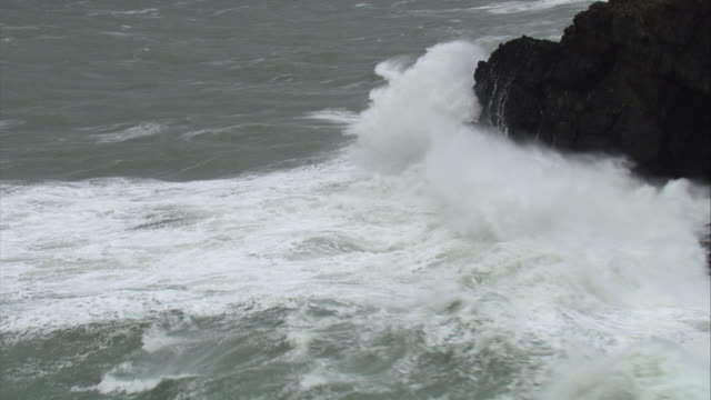 aerial over stormy sea crashing against cliff, cornwall, uk - coastline stock videos & royalty-free footage