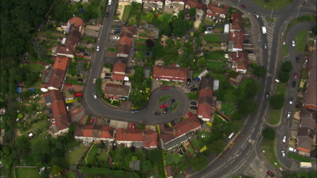 aerial over suburban streets and houses, london, uk - suburban stock videos & royalty-free footage