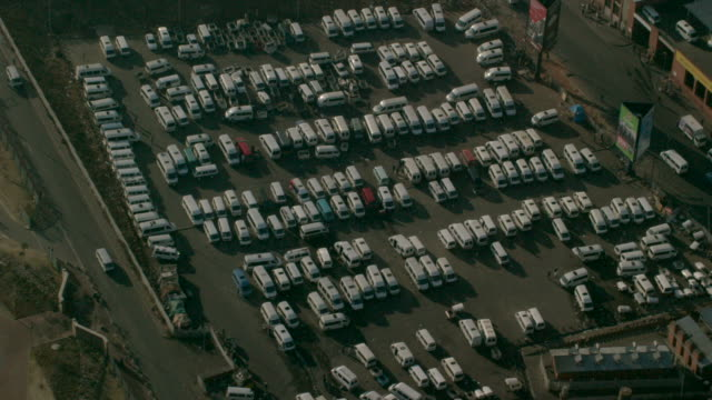 aerial over taxis parked at a taxi rank - taxi rank stock videos & royalty-free footage