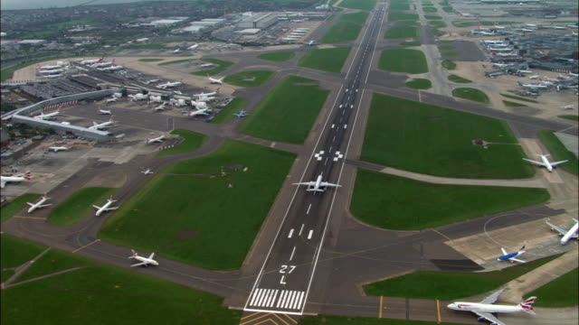 aerial over terminal 4 and southern runway, heathrow airport, london - heathrow airport stock videos and b-roll footage