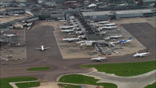 aerial over terminals 1, 2 and 3 and runways, heathrow airport, london - heathrow airport stock videos and b-roll footage