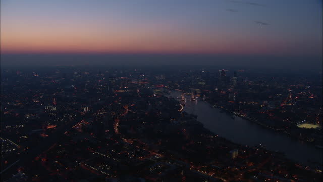 Aerial over Thames at dusk / London