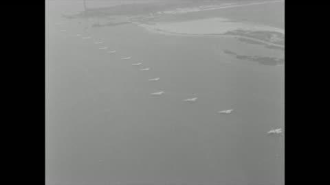 vídeos y material grabado en eventos de stock de aerial over the 24 italian seaplanes anchored in a long row just off the coast / seaplane taxis / it takes off / two more take off flying by... - anclado