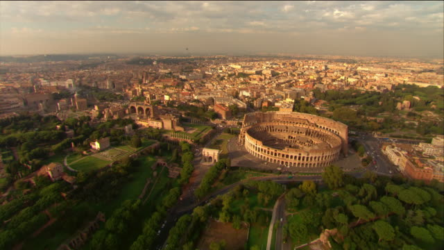 Aerial over the Colosseum and the city of Rome / Italy