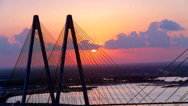 Aerial over the Fred Hartman Bridge at sunset over the Houston Ship Channel / Baytown, Texas