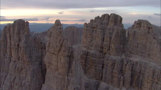 vídeos de stock, filmes e b-roll de aerial over the mountains italy, aerial cinematography - padrão natural