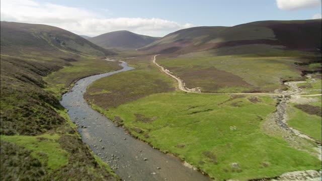 Aerial over the River Avon running through Glen Avon in the Cairngorms / Highland, Scotland