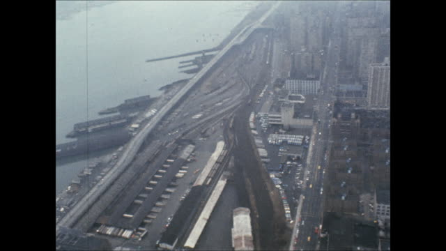 aerial over the train yard along the west side highway in new york city. - 操車場点の映像素材/bロール