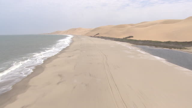 aerial over the water in namibia right along the coastline - aerial or drone pov or scenics or nature or cityscape stock videos & royalty-free footage