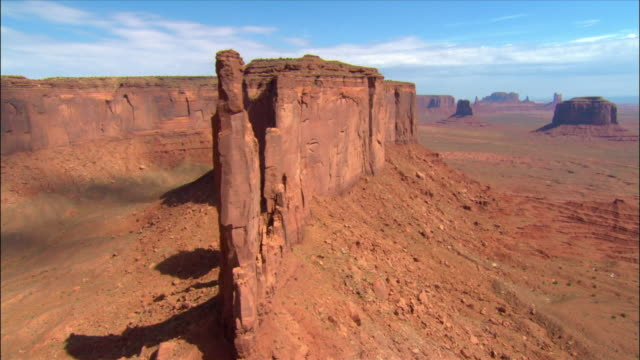 aerial over 'three sisters' rock formation / monument valley - monument valley stock videos & royalty-free footage