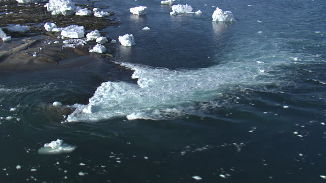 aerial over tidal rapids and sea ice, quebec, canada - tide stock videos & royalty-free footage