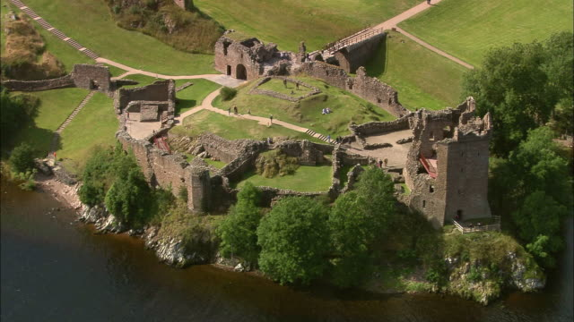 Aerial over tourists visiting Urquhart Castle / Highland, Scotland