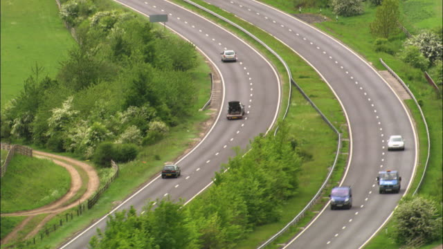 aerial over traffic on a303 dual carriageway, wiltshire, uk - articulated lorry stock videos & royalty-free footage