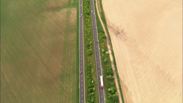 Aerial over traffic on A303 dual carriageway, Wiltshire, UK