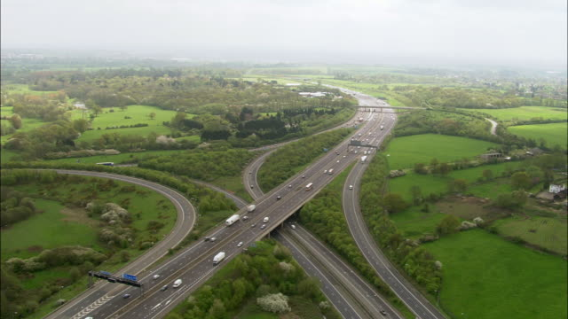 Aerial over traffic on motorway, UK
