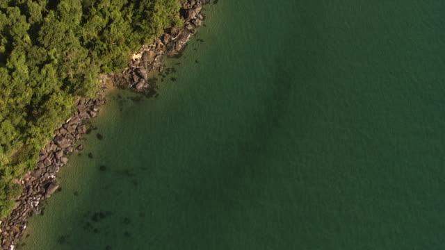 Aerial over tropical sea and forested coast, Madagascar