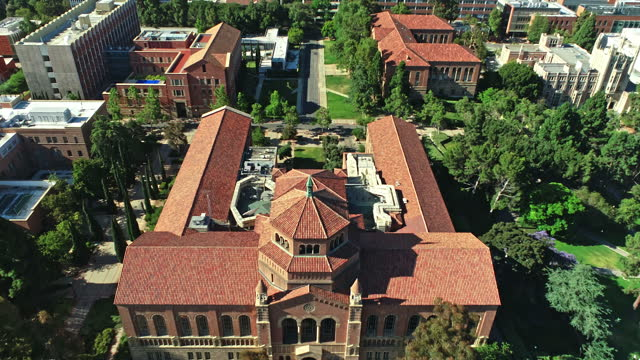 aerial over ucla westwood campus looking south from royce hall and  fowler museum towards ronald reagan medical center and wilshire corridor in far distance - westwood neighborhood los angeles stock videos & royalty-free footage