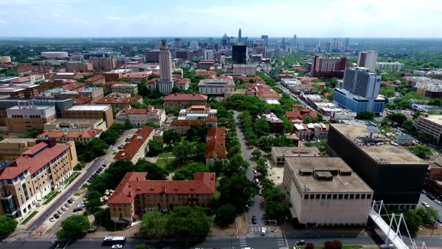 Aerial Over University of Texas Campus UT Clock Tower Austin Texas Skyline Panning to the Side