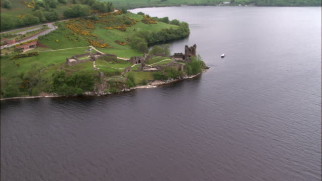 Aerial over Urquhart Castle on shore of Loch Ness, Scotland